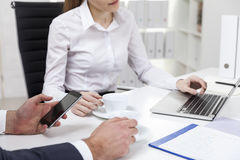 Close up of woman in white blouse and her colleague in office Stock Photo