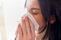 Close up of woman with wipe blowing nose or crying Stock Image