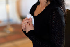 Close up of woman with wipe at funeral in church Stock Image