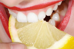 Free Close-up Woman With White Teeth And Lemon Stock Photos - 39469773