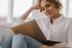 Close up of a woman working on laptop at home stock images