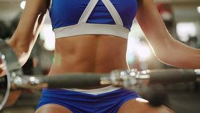 Close up of woman workout on training simulator in crossfit gym 4K.  stock footage