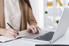 Close up of woman's hands. She is writing. Stock Photos