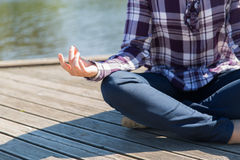 Close up of woman in yoga lotus pose outdoors Royalty Free Stock Image