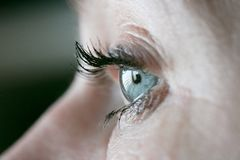 Close up on a womans eye when its open Stock Photography