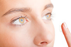 Close up of Womans Face Inserting a Contact Lens Royalty Free Stock Photography
