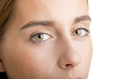 Close up of Womans Face. Close up of a young woman face, focusing on the eyes, looking at camera Royalty Free Stock Photography