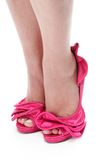 Close up of womans feet in hot pink stilettos Royalty Free Stock Images