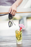 Close-up of womans hand holding sunglasses Stock Image