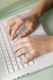 Close up womans hands and a laptop Stock Photography