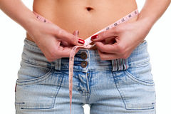 Close up of womans waist and tape measure Stock Image