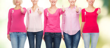 Close up of women with cancer awareness ribbons Royalty Free Stock Photography