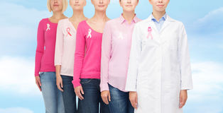 Close up of women with cancer awareness ribbons Stock Photos