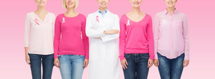 Close up of women with cancer awareness ribbons Royalty Free Stock Image