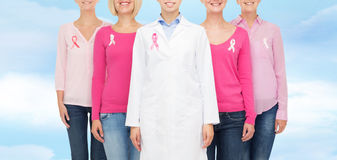 Close up of women with cancer awareness ribbons Stock Image