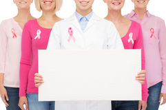 Close up of women with cancer awareness ribbons Royalty Free Stock Photos