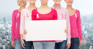 Close up of women with cancer awareness ribbons Stock Images