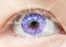Close-up women eye technology : contact lens Stock Photography