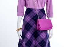 Close up women fashionable skirt and accessories. Female mannequin with blouse, patterned skirt and bracelets. Ladies fashion look Stock Photography