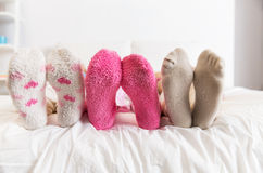 Close up of women feet in socks on bed at home royalty free stock photo