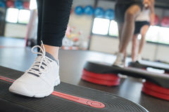 Close up women foot exercising with stepper in gym Stock Image