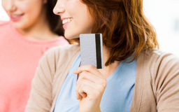 Close up of women or friends with credit card Royalty Free Stock Image