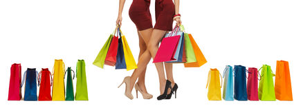 Close up of women on high heels with shopping bags royalty free stock photography