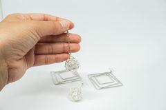 Close up women hold cute creative earring with left hand for party royalty free stock photography