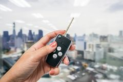 Close up women hold modern car remote control stock photos