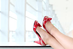 Close-up on women's feet with red shoes with high heels. Closeup on red woman's hills Royalty Free Stock Photo