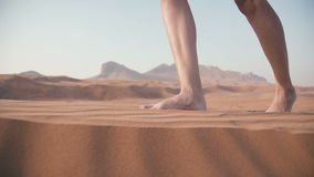 Close-up of women`s feet sink in the sand. Walk in the desert. stock video footage