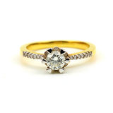 Close up of Women's golden wedding ring with diamond isolated on Stock Image