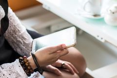Close up of women`s hands holding cell telephone blank copy spac Royalty Free Stock Photography