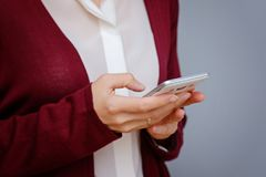 Close up of women`s hands holding cell telephone with blank copy space. Smartphone stock photos