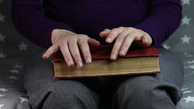 Close-up women`s hands are nervous. Old book stock video footage