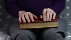 Close-up women`s hands are nervous. Old book stock video