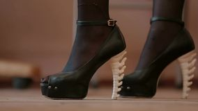 Close-up of women's high-heeled shoes stock video footage