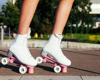 Close-up of women`s legs dressed in fashionable vintage roller skates derby quads Stock Photo