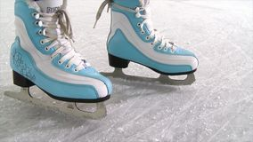 Close-up of women`s legs on skates in winter on an skating rink. Scene. Woman skating close-up.  stock video