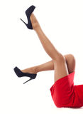 Close up women's slender legs in high heels. Isolated white background stock images
