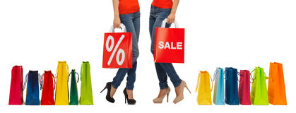 Close up of women with sale sign on shopping bag stock images