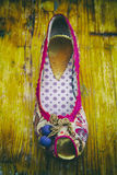 Close-up of women shoe. On wood. Bright colors royalty free stock photo