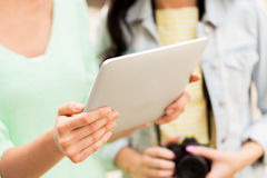 Close up of women with tablet pc and camera Stock Images