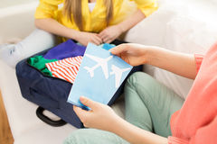 Close up of women with tickets and travel bag Stock Photos