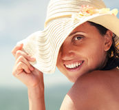 Close up womqn portrait in big summer hat Royalty Free Stock Images
