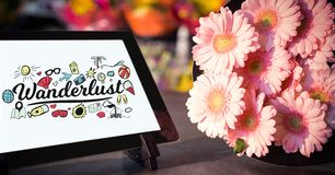Close-up of wonderful text on device screen on tablet computer by flowers on table Royalty Free Stock Images