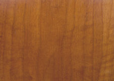 Close up of wood background grain texture. This is a brown wood with grain texture royalty free stock photo