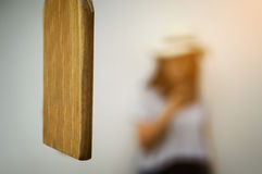 Close up of Wood Bell Lumber and blurred woman background. royalty free stock photo