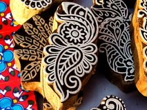 Close up of a Wood Block-India. Close up of wood block with floral design engraved on it in a beautiful golden light of evening. Wood block are tradionally used stock photo