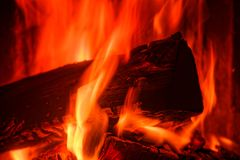 Close-up of wood burning in a stove. Close-up of red flames from burning wood in a stove royalty free stock photo